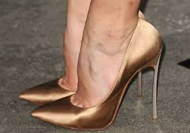 Because nothing says yummy and sexually alluring like hammertoe cleavage.